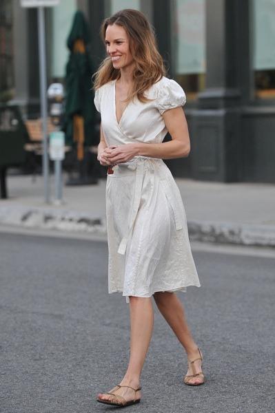Hilary Swank in beige wrap dress