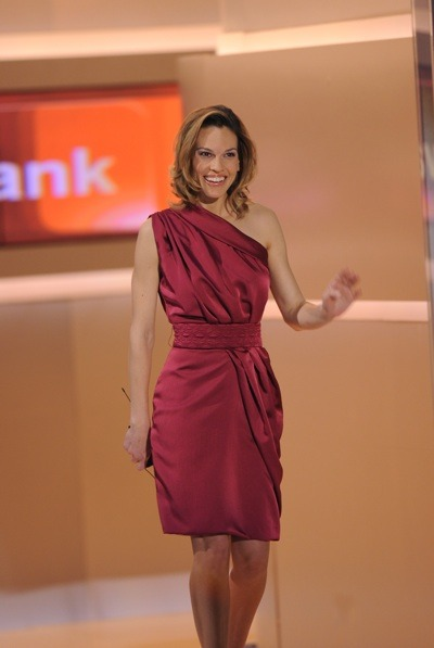 Hilary Swank in burgundy