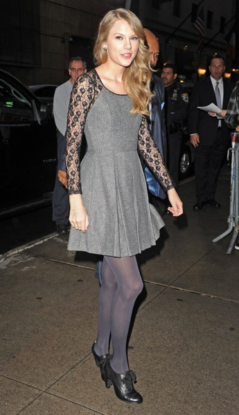 Taylor Swift in grey jumper