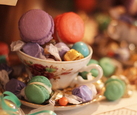 Teacups filled with macarons