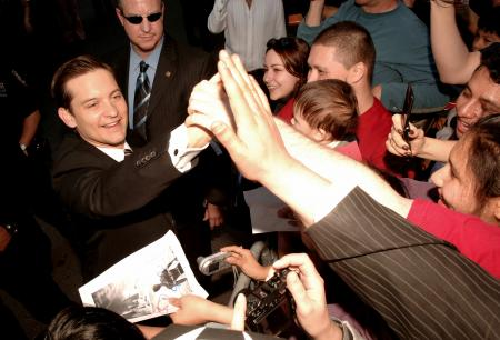Tobey Maguire signs autographs for his fans