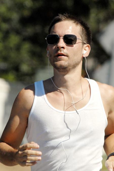 Tobey Maguire running with sunglasses