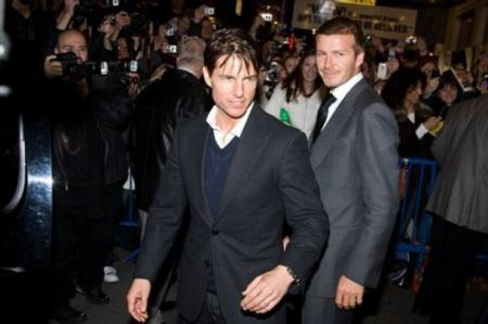 Tom Cruise and David Beckham are greeted by the paparazzi