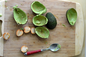 Pit and peel an avocado