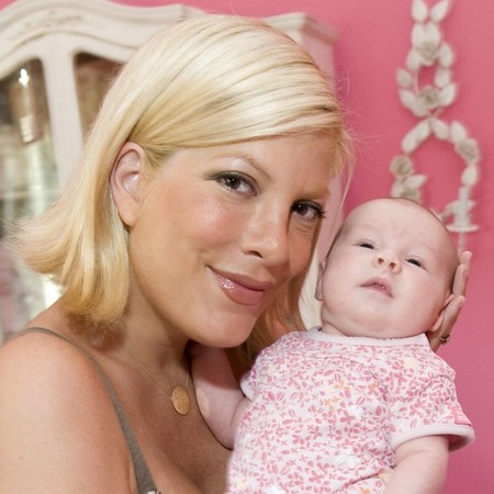 Tori Spelling with newborn Stella