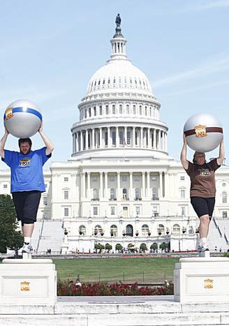 Toughest Biggest Loser Workouts Season 8 Liz and Rudy Holding Up Balls in Washington DC