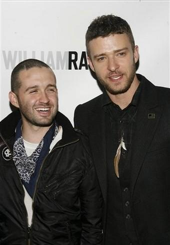 Trace Ayala laughs next to Justin Timberlake at a William Rast publicity event
