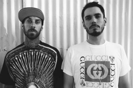 Travis Barker poses with friend DJ AM