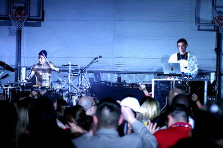 Travis Barker on stage with DJ AM