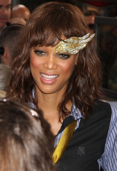 Tyra Banks in silver and gold sequins