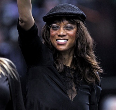 Tyra Banks in knit beret