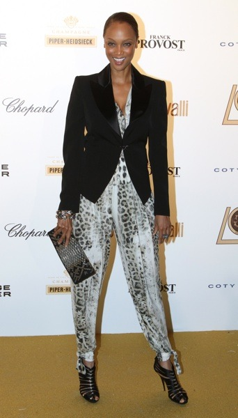 Tyra Banks in animal print jumpsuit
