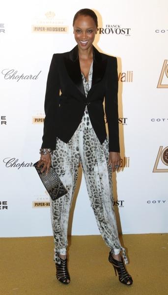 Tyra Banks in animal print jumpsuit