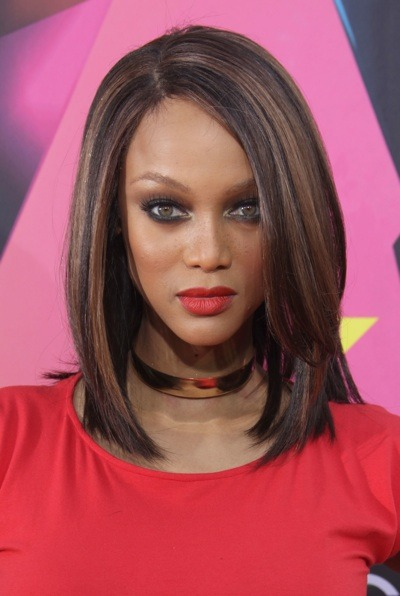 Tyra Banks with orange lipstick