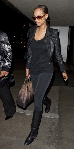 Tyra Banks in bomber jacket