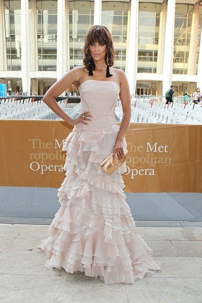 Tyra Banks in pale pink ruffles