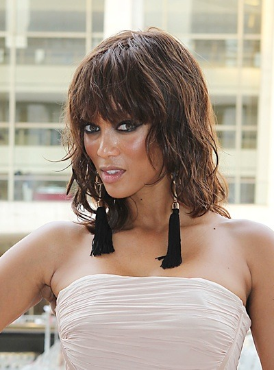 Tyra Banks with beach waves