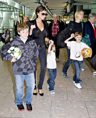 Victoria Beckham with her sons.