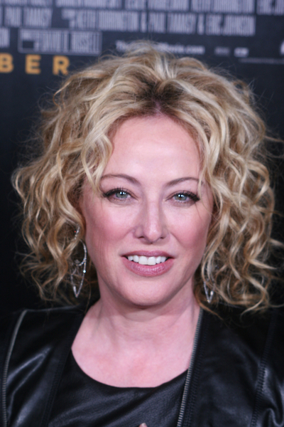Virginia Madsen's curly, blonde hairstyle