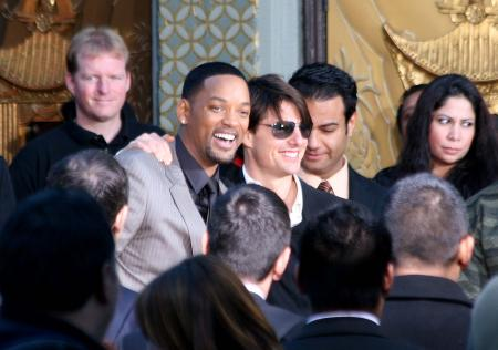 Will Smith and Tom Cruise smile to the crowd