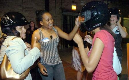 Trying on helmets at a Harley-Davidson Garage Party