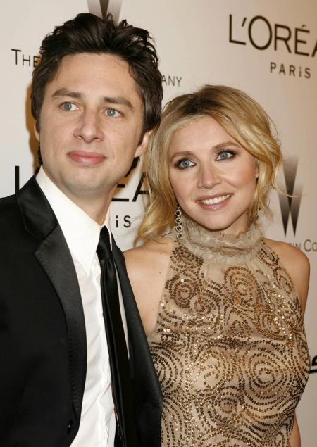 Sarah Chalke and Zach Braff attend the Emmy Awards. Post your own