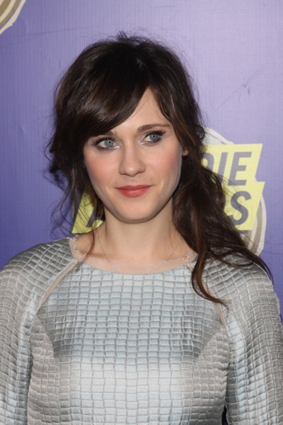 Zooey Deschanel with a side ponytail