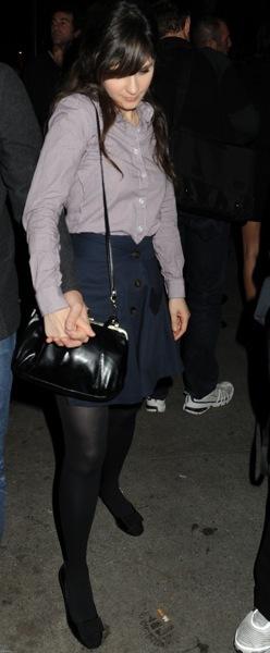 Zooey Deschanel in a black mini skirt