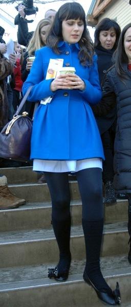 Zooey Deschanel in a blue coat