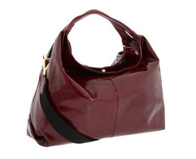 Furla.  Add to wish list.  This burgundy patent leather hobo offers...