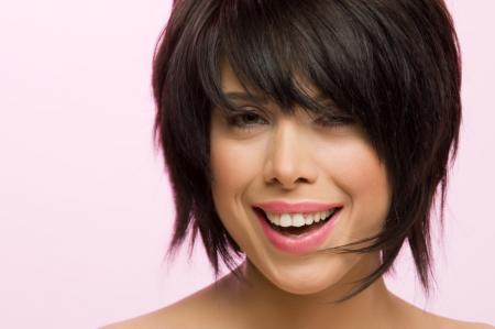 This choppy, layered bob features long, blunt bangs. To achieve this style,