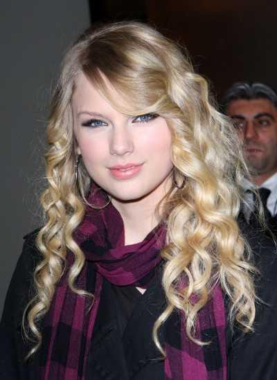 Taylor Swift's Long Blonde Curly Hairstyle. Wearing romantic and whimsical