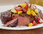 Beef steaks with yellow pepper and onion relish