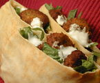 Chickpea Fritter Pitas with Garlicky Yogurt Sauce 