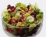 Mixed leafy greens with warm bacon dressing
