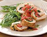 Spinach and tomato-stuffed chicken roulade