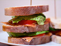 Salmon lettuce tomato sandwich
