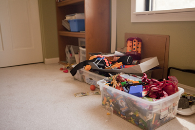 Red room toy storage before