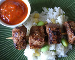 Beef kebabs with roasted red pepper sauce