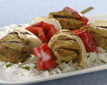 Grilled Indian pork kebabs with sweet onions and red bell peppers